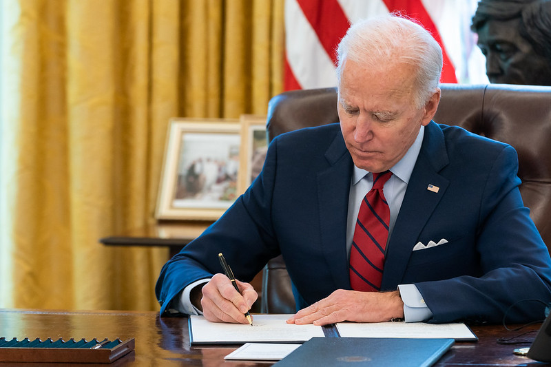 biden signing orders in oval office