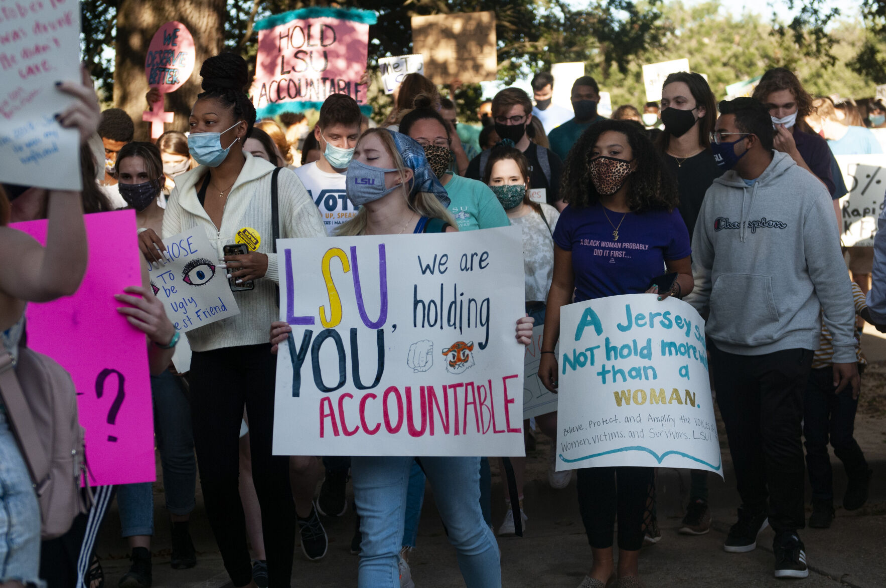Women walk in LSU Protest of Sexual Assaults