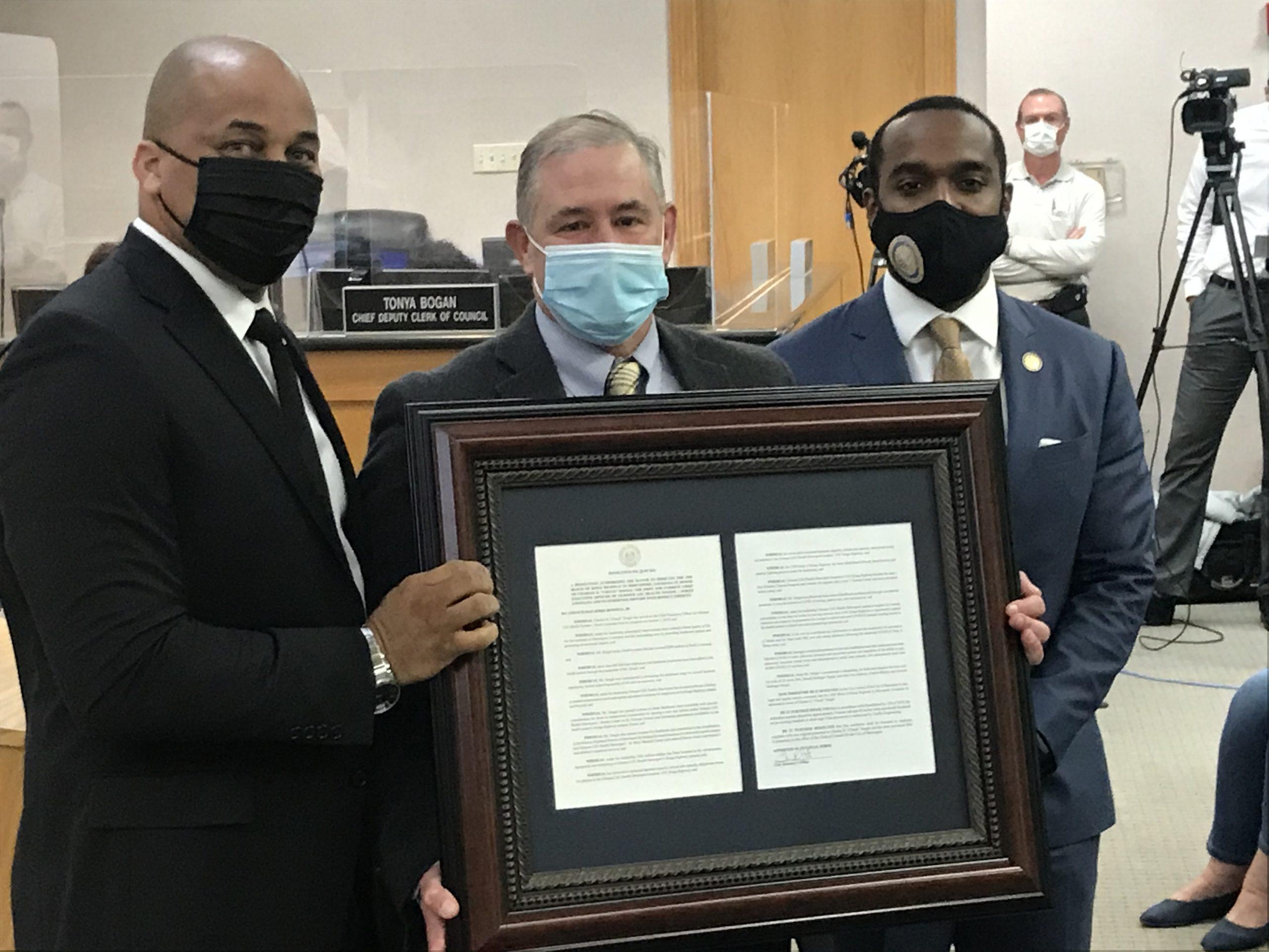 Chuck Daigle Ochsner receives city council award alongside Bowman and Mayor Perkins