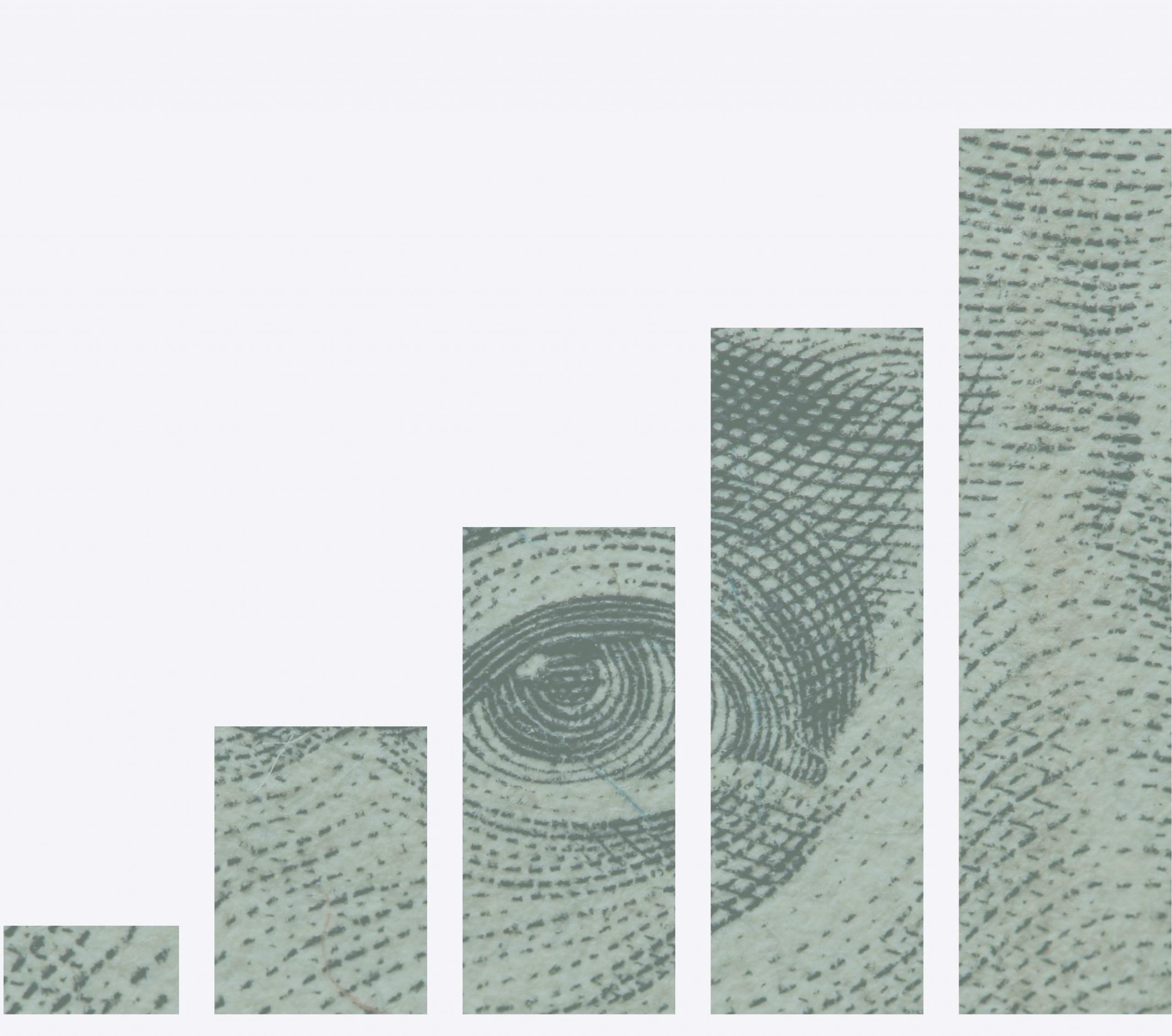 increasing bar graph with a dollar bill peeking through